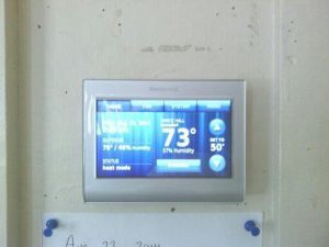 12-08-26 Bill Chidsey photo of new thermostat